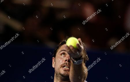 Stock Photo of Stan Wawrinka of Switzerland serves in his match against Ryan Harrison of the U.S., during round one play at the Mexican Tennis Open in Acapulco, Mexico
