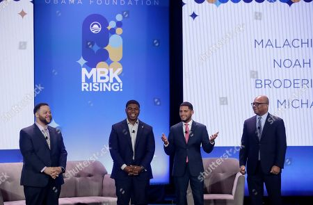 Michael Smith, from left, stands on stage with Noah McQueen, Malachi Hernandez and Broderick Johnson at the My Brother's Keeper Alliance Summit in Oakland, Calif