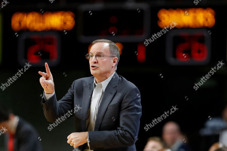 Stock Photo of Oklahoma head coach Lon Kruger directs his team during the first half of an NCAA college basketball game against Iowa State, in Ames, Iowa