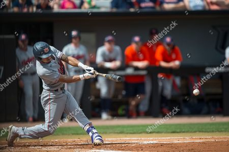 Auburn's Will Holland (17) hits a single during an NCAA college baseball game against Central Florida, in Orlando, Fla