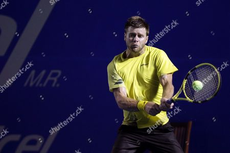 Ryan Harrison of the USA in action against Stan Wawrinka of Switzerland during their first round match at the Mexican Open tennis tournament in Acapulco, Mexico, 25 February 2019.