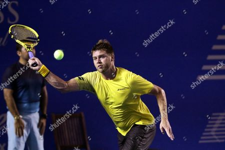 Stock Picture of Ryan Harrison of the USA in action against Stan Wawrinka of Switzerland during their first round match at the Mexican Open tennis tournament in Acapulco, Mexico, 25 February 2019.