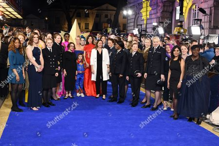 Lashana Lynch, Brie Larson, Gemma Chan, Anna Boden and Victoria Alonso with members of the UK Armed Forces