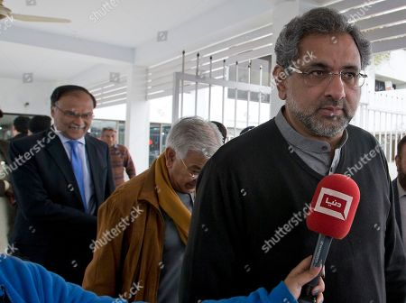 """Pakistan former Prime Minister Shahid Khaqan Abbasi, right, leaves with former Defense Minister Khawaja Asif, center, and lawmaker Ahsan Iqbal after attending a Parliament session that debated recent Indian strikes, in Islamabad, Pakistan. Pakistan says India launched an airstrike on its territory early Tuesday that caused no casualties, while India said it targeted a terrorist training camp in a pre-emptive strike that killed a """"very large number"""" of militants"""