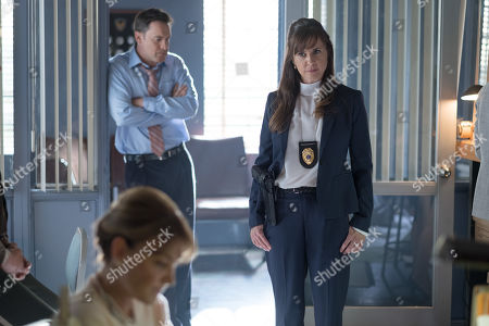 Stock Image of Lane Edwards as Dale Locke and Kellie Martin as Agent Murray