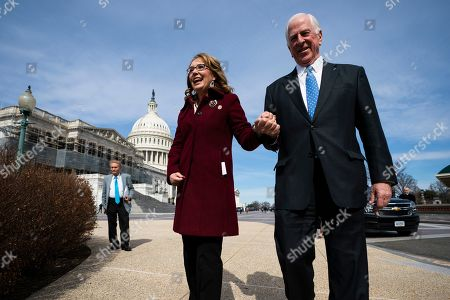 Democratic Representative from California Mike Thompson (R) walks with former Democratic Representative from Arizona Gabby Giffords (L) before the two spoke on the bipartisan background checks bill in Washington, DC, USA, 26 February 2019.  The legislation would require all gun sellers to perform background checks.