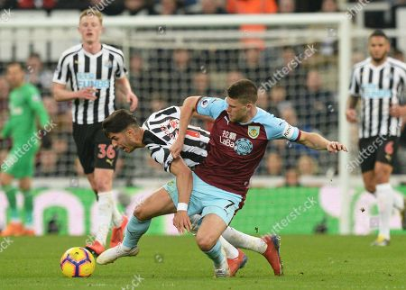 Ayoze Perez of Newcastle United vies for the ball with Johann Berg Gudmundsson