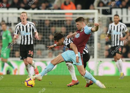 Stock Image of Ayoze Perez of Newcastle United vies for the ball with Johann Berg Gudmundsson