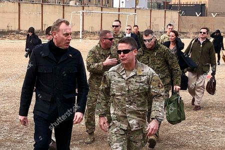 Patrick Shanahan, Scott Miller. In this, photo, acting Defense Secretary Patrick Shanahan, left, arrives in Kabul, Afghanistan to consult with Army Gen. Scott Miller, right, commander of U.S. and coalition forces, and senior Afghan government leaders. Shanahan, the former Boeing executive, was in a familiar place, aboard an airplane, when he got word of a bolt-from-the-blue political shot across his bow. A key senator seemed to have buried Shanahan's chances of being nominated as the next secretary of defense. The crisis passed, but it highlighted the precarious position Shanahan occupies as he waits for President Donald Trump to decide who he will successor to Jim Mattis as leader of the Pentagon