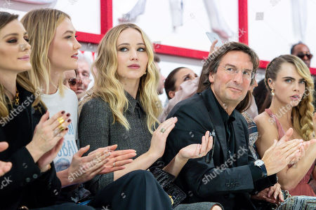 Stock Photo of Karlie Kloss, Jennifer Lawrence, Pietro Beccari and Cara Delevingne in the front row