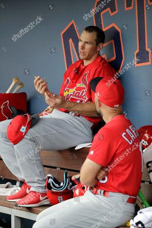 St. Louis Cardinals' Paul Goldschmidt, left, talks with teammate Matt Carpenter during an exhibition spring training baseball game against the Washington Nationals, in West Palm Beach, Fla