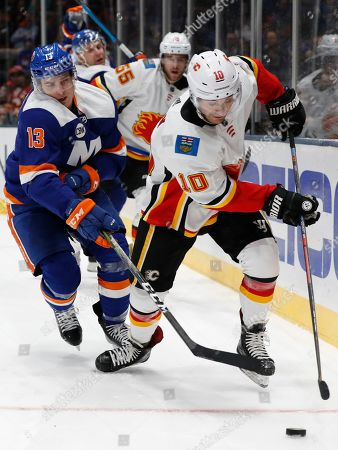 Mathew Barzal, Derek Ryan. New York Islanders center Mathew Barzal (13) pursues Calgary Flames center Derek Ryan (10) behind the Flames net in the second period of an NHL hockey game, in Uniondale, N.Y