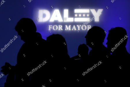 Supporters wait for Chicago mayoral candidate Bill Daley during an election night celebration in Chicago, . Fourteen candidates are vying for the top job, a historically large field. If no candidate gets 50 percent of the vote, the top two vote-getters face off again on April 2