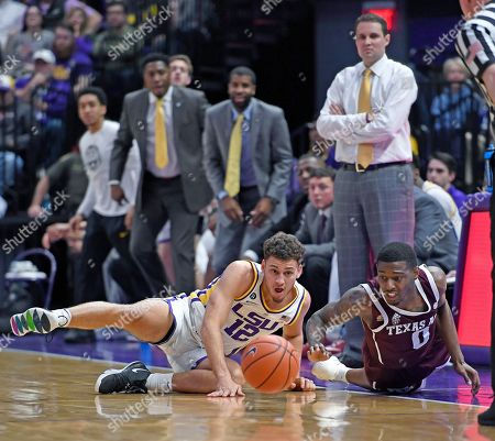 Will Wade, Marshall Graves, Jay Jay Chandler. As LSU head coach Will Wade watches, upper right, LSU guard Marshall Graves (12) and Texas A&M guard Jay Jay Chandler (0) dive after a loose ball in the first half of an NCAA college basketball game, in Baton Rouge, La. LSU won 66-55