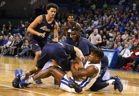 Buffalo Bulls forward Nick Perkins (33) is out numbered battling for a loose ball against Akron Zips forward Emmanuel Olojakpoke (22), and guard Tyler Cheese (4) during the first half of play in the NCAA Basketball game between the Akron Zips and Buffalo Bulls at Alumni Arena in Amherst, N.Y. (Nicholas T