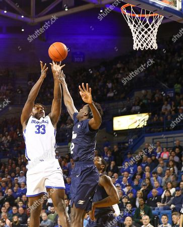 Buffalo Bulls forward Nick Perkins (33) shoots for two points over Akron Zips forward Emmanuel Olojakpoke (22) during the first half of play in the NCAA Basketball game between the Akron Zips and Buffalo Bulls at Alumni Arena in Amherst, N.Y. (Nicholas T