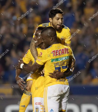 Tigre's Javier Aquino (top), Julian Quinones (L) and Enner Valencia (R) celebrate after a goal during a match of the CONCACAF's Liga de Campeones between Tigres of Mexico and Deportivo Saprissa of Costa Rica at the Universitario Stadium in Monterrey, Mexico, 26 February 2019.