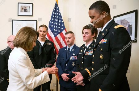 Nancy Pelosi, Ian Brown. Released by the her office, Speaker of the House Nancy Pelosi, D-Calif., left, gives challenge coins to U.S. Army Maj. Ian Brown, right, and other military service members to thank them for their service, in her office at the Capitol following the State of the Union address in Washington. Brown, 38, is a two-time Bronze Star recipient who transitioned from female to male while advising the Army's deputy chief of staff in operations and planning