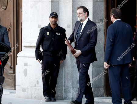Former Spanish Prime Minister Mariano Rajoy leaves the Spanish Supreme Court after testifying as witness in a new session of the trial of the so-called 'proces' case against 12 Catalan pro-independence politicians involved in the illegal referendum held back in 2017, in Madrid, Spain, 27 February 2019. Several witnesses, including former Prime Minister Mariano Rajoy, former Deputy Prime Minister Soraya Saenz de Santamaria and former Catalan regional President Artur Mas, are expected to testify later today.