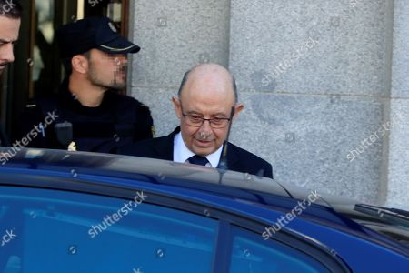Stock Photo of Former Spanish Treasury Minister Cristobal Montoro leaves Supreme Court after testifying before the court as a witness during a new session of the trial of the so-called 'proces' case against 12 Catalan pro-independence politicians involved in the illegal referendum held back in 2017, in Madrid, Spain, 27 February 2019. Nine of the 12 pro-independence leaders are accused of rebellion and embezzlement for their role in the Catalan illegal independence referendum back in 2017, while the other three accused face disobedience charges. More than 500 people have been called to declare, some of them former members of the Spanish Government such as former Prime Minister Mariano Rajoy.