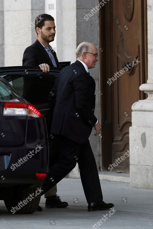 Stock Picture of Former Spanish Treasury Minister Cristobal Montoro (R) upon his arrival in the Spanish Supreme Court to testify as witness in a new session of the trial of the so-called 'proces' case against 12 Catalan pro-independence politicians involved in the illegal referendum held back in 2017, in Madrid, Spain, 27 February 2019.