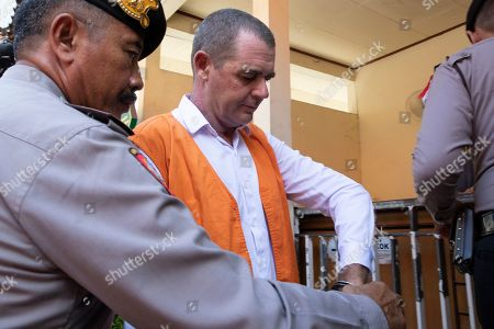 Brendon Luke Johnson of Australia escorted by police officer for his verdict trial at Denpasar district court in Denpasar, Bali, Indonesia, 27 February 2019. Indonesian jugdes sentenced Brendon to five years and four month in jail for possession of 11.6 gram of cocaine.