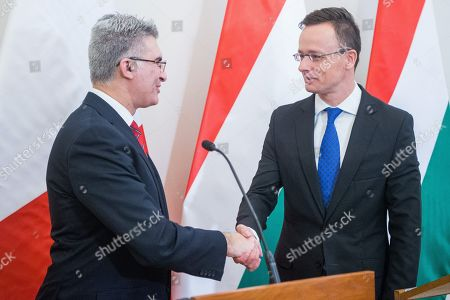 Hungarian Minister of Foreign Affairs and Trade Peter Szijjarto (R) and Minister of Foreign Affairs of Malta, Carmelo Abela shake hands after their joint press conference at the Minister of Foreign Affairs and Trade in Budapest, Hungary, 27 February 2019.