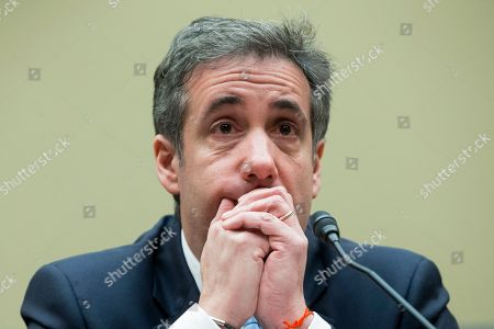 Michael Cohen, former attorney to US President Donald J. Trump, reacts while listening to the closing remarks of House Oversight and Reform Committee Chairman Elijah Cummings, while appearing before the House Oversight and Reform Committee in the Rayburn House Office Building in Washington, DC, USA, 27 February 2019. Cohen is scheduled to testify before three congressional committees over three days. Lawmakers plan to grill the convicted felon over the Trump Tower Moscow project, and Cohen's facilitation of hush money payments to two women who alleged to having affairs with Trump before he took office.