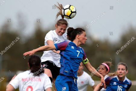 Canada's Janine Beckie (L) in action against Iceland's Sara Bjork Gunnarsdottir (R) during the Algarve Cup soccer match between Canada and Iceland held at Bela Vista stadium in Parchal, Faro, Portugal, 27 February 2019.