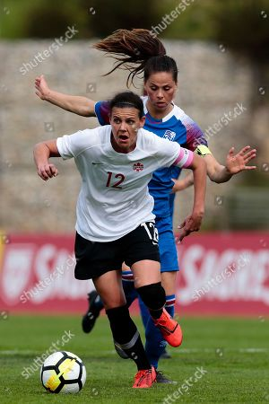 Canada's Christine Sinclair (L) in action against Iceland's Sara Bjork Gunnarsdottir (R) during the Algarve Cup soccer match between Canada and Iceland held at Bela Vista stadium in Parchal, Faro, Portugal, 27 February 2019.