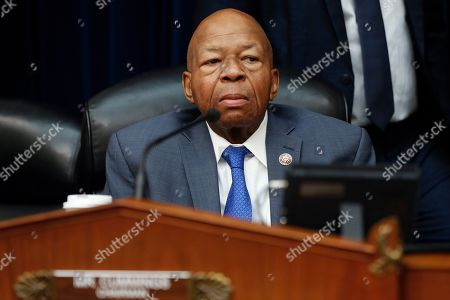 House Oversight and Reform Committee Chair Elijah Cummings, D-Md., watches during a break in testimony by Michael Cohen, President Donald Trump's former lawyer, on Capitol Hill in Washington