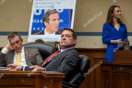 Stock Picture of Mark E. Green, Kelly Armstrong. Rep. Mark E. Green, R-Tenn., center, with Rep. Kelly Armstrong, R-N.D., left, listen as Michael Cohen, President Donald Trump's former personal lawyer, testifies before the House Oversight and Reform Committee about his behind-the-scenes knowledge of Trump's activities, including possible criminal conduct, on Capitol Hill in Washington