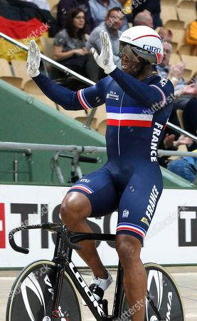 Team France's Gregory Bauge waves after the men's team sprint final at the UCI Track Cycling World Championship in Pruszkow, Poland
