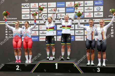 Gold medalists Australia's Stephanie Morton, right, and Kaarle McCulloch, silver medalists Russia's Daria Shmeleva and Anastasiia Voinova, bronze medalists Germany's Miriam Welte and Emma Hinze wave after the women's team sprint final at the UCI Track Cycling World Championship in Pruszkow, Poland