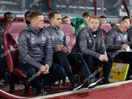 Celtic's Interim Manager Neil Lennon (R) in the dugout with Celtic first team coach Damien Duff (L) & Celtic Assistant Manager John Kennedy (C).