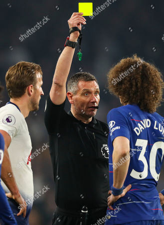 Referee Andre Marriner shows David Luiz and Harry Kane a yellow card each