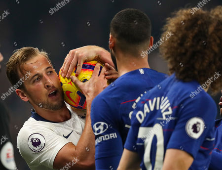 Harry Kane of Tottenham Hotspur tries to wrestle ball away
