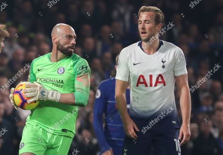 Willy Caballero of Chelsea saves as Harry Kane of Tottenham Hotspur looks on