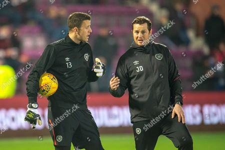 Stock Image of Goalkeeper Colin Doyle (#13) of Heart of Midlothian (left) speaks with coach Jon Daly before the Ladbrokes Scottish Premiership match between Heart of Midlothian and Celtic at Tynecastle Stadium, Edinburgh