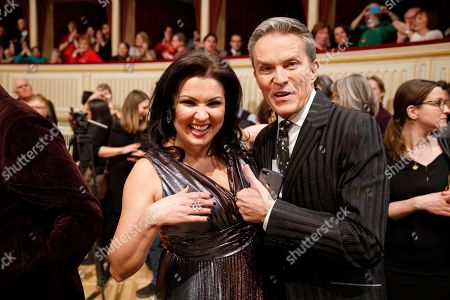 Russian-Austrian soprano Anna Netrebko (L) and Austrian TV-host Alfons Haider (R) pose for the media during a dress rehearsal for the traditional 63rd Vienna Opera Ball at the Vienna State Opera in Vienna, Austria, 27 February 2019. The Vienna Opera Ball takes place on 28 February.