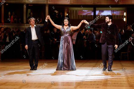 Conductor Marco Armiliato (L), Russian-Austrian soprano Anna Netrebko (C) and Azerbaijani tenor Yusif Eyvazov (R) and perform during a dress rehearsal for the traditional 63rd Vienna Opera Ball at the Vienna State Opera in Vienna, Austria, 27 February 2019. The Vienna Opera Ball takes place on 28 February.