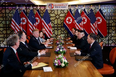 President Donald Trump speaks during a meeting with North Korean leader Kim Jong-un, in Hanoi. At front right is Kim Yong-Chol, a North Korean senior ruling party official and former intelligence chief. At left is national security adviser John Bolton and Secretary of State Mike Pompeo, second from left