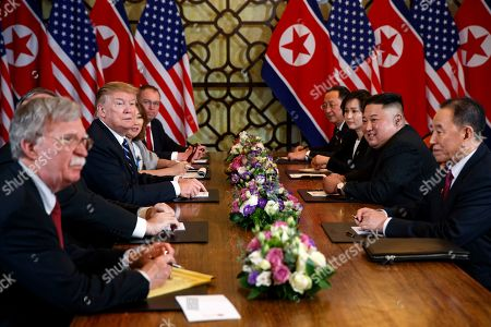 President Donald Trump speaks during a meeting with North Korean leader Kim Jong-un, in Hanoi. At front right is Kim Yong-Chol, a North Korean senior ruling party official and former intelligence chief. At left is national security adviser John Bolton