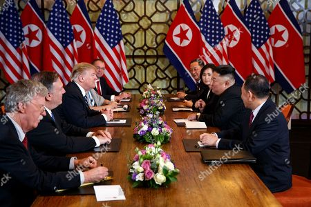 President Donald Trump speaks during a meeting with North Korean leader Kim Jong-un, in Hanoi. At front right is Kim Yong-Chol, a North Korean senior ruling party official and former intelligence chief. At left is national security adviser John Bolton and Secretary of State Mike Pompeo, second from left. Behind Trump is acting chief of staff Mick Mulvaney