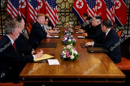 President Donald Trump meets with North Korean leader Kim Jong-un, in Hanoi. At front right is Kim Yong-Chol, a North Korean senior ruling party official and former intelligence chief. At left is national security adviser John Bolton and Secretary of State Mike Pompeo, second from left