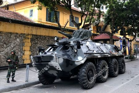 "A Vietnamese armored personnel carrier deployed to secure talks between U.S. President Donald Trump and North Korean leader Kim Jong-un stands watch outside the gatehouse of the Hoa Lo Prison in central Hanoi, Vietnam on. The prison, commonly called the ""Hanoi Hilton,"" is where American prisoners of war included Sen. John McCain were held during the Vietnam War"