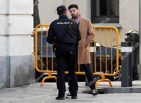 Stock Image of Catalan pro-independence ERC party's spokesperson and Member in Parliament, Gabriel Rufian, speaks with a police officer as he arrives at the Supreme Court in Madrid to testify as witness in the so-called 'proces' trial against 12 Catalan separatists leaders involved in the illegal independence referendum held back in 2017, in Madrid, Spain, 28 February 2019. Barcelona's Mayoress, Ada Colau, the former Minister of Interior Juan Ignacio Zoido and the Basque regional President, Inigo Urkullo, are among the ten witnesses called to testify in the trial along the day.