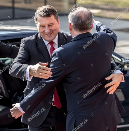 Latvian President Raimonds Vejonis (L) is welcomed by Slovak President Andrej Kiska (R) before the Meeting of Presidents of States of Central and Eastern Europe (called the Bucharest format, or B9), in Kosice, Slovakia, 28 February 2019. The B9 countries' presidents from Bulgaria, Czech Republic, Estonia, Lithuania, Latvia, Hungary, Poland, Romania and Slovakia together with NATO Secretary General Jens Stoltenberg, commemorate the 70th anniversary of the North Atlantic Treaty Organization (NATO), the 15th anniversary of the accession of the Slovak Republic and other B9 members to NATO, and the 20th anniversary of the accession of the Czech Republic, Hungary and Poland. Main subjects discussed at this meeting are expected to be the increasing spreading of misinformation and the defence against cyber threats and propaganda. The current security situation in Europe and its neighbourhood will also be a topic of the discussions.