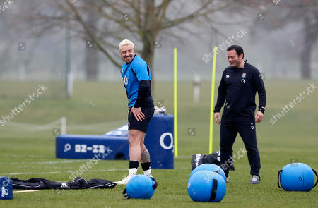 Jack Nowell training on his own under the supervision of former England captain Will Carling