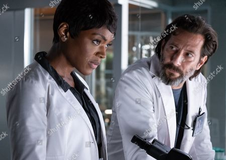 Caroline Chikezie as Dr. Major Nichole Sykes and Henry Ian Cusick as Dr. Jonas Lear